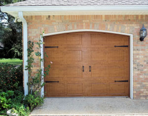 Oak AccuFinish Carriagehouse Stamp Garage Door