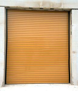 Custom Orange Rolling Commercial Door