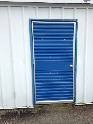 Swinging mini warehouse door unit