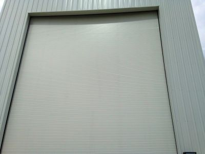"24'10"" X 33' 18 gauge rolling steel door, 140 MPH windrated door"