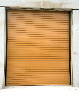 Custom Orange Rolling Commercial Door